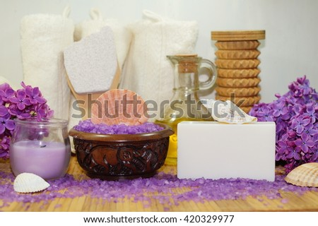 Spa in flower color lilac - Aromatic soap, scented bath salt, and oil, and accessories for massage and bath - stock photo