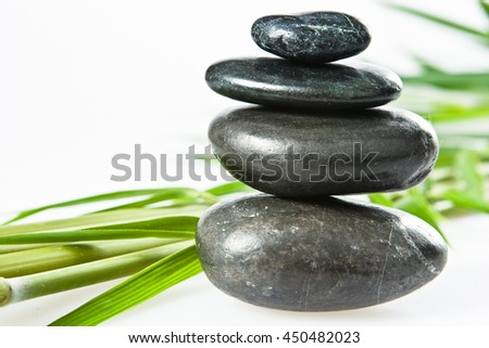 spa la stone health therapy pebbles stack isolated on white with bamboo - stock photo