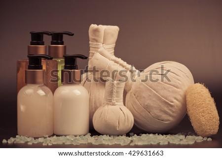 Spa Massage  body care product,shower,shampoo,lotion and blue sea salt - stock photo