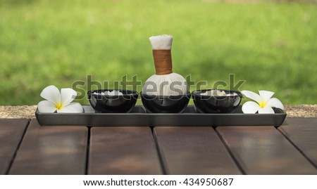 Spa massage compress balls, herbal ball with flower, Thailand  - stock photo
