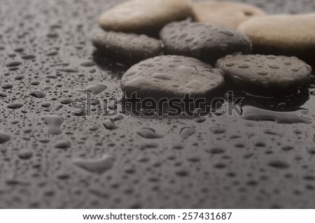 Spa massage stones with water drops, close up - stock photo