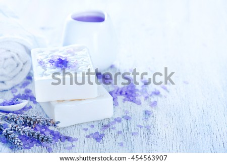 spa objects, lavender soap and towel on a table - stock photo