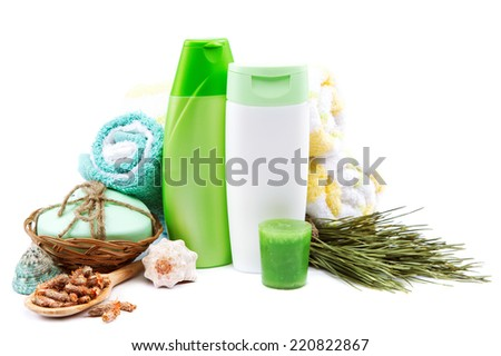 Spa or bathroom concept. Shampoo, cream, soaps, towels and pine cones on a white background. - stock photo