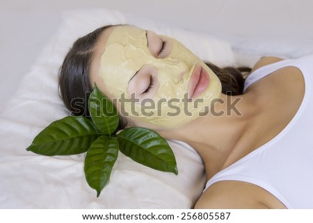 Spa Outdoor, Beautiful young woman lying with natural Indian Multani Matti clay facial mask on her face, skin care and wellness