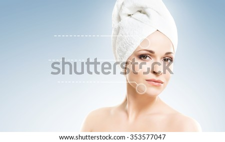 Spa portrait of a young and healthy woman with pointer arrows on her face. Plastic surgery concept. - stock photo