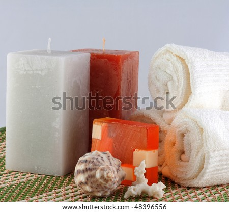 Spa products, candle, soap, towel - stock photo