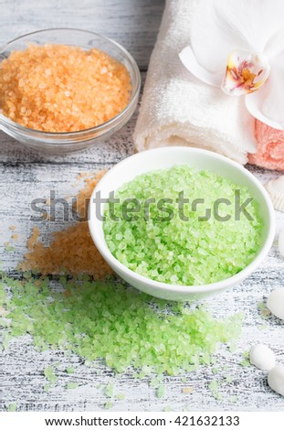 Spa salon with sea salt and towels. - stock photo