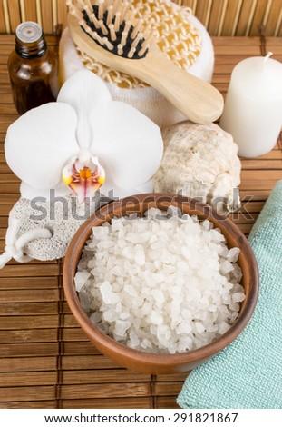 Spa salon with sea salt  on the bamboo board - stock photo