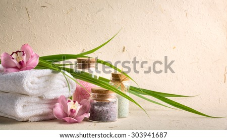 Spa salt,towel and orchid flower. - stock photo