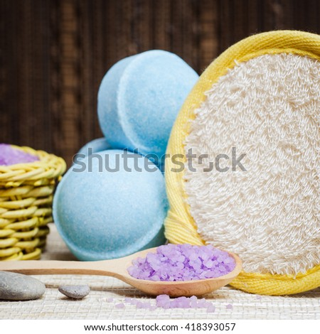 Spa salt, wisp, towel and bath bomb for beauty and health. Healthy relaxation, therapy and treatment. Aromatherapy, body care, aroma massage. Alternative lifestyle. Relax in bath. - stock photo