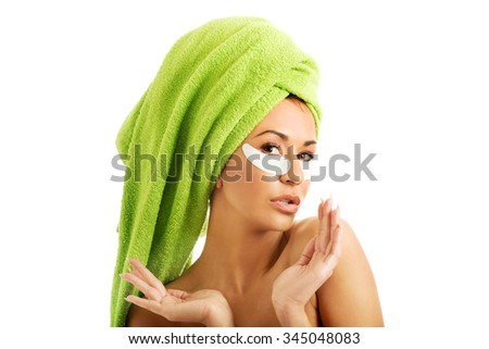 Spa serene woman with gel eye mask - stock photo