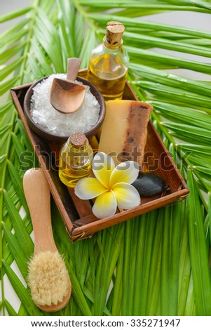 Spa set in wooden bowl with perfume ,spoon on palm    - stock photo