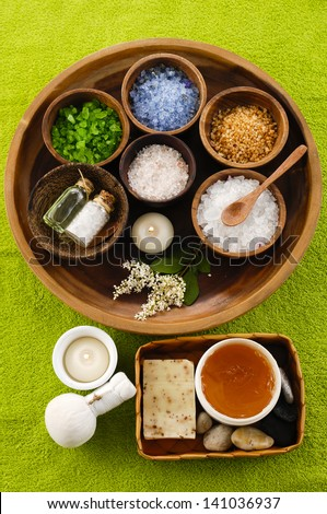 Spa set on green towel - stock photo