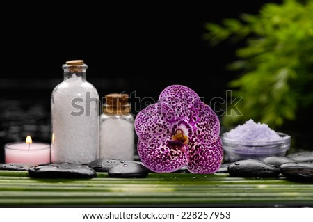 Spa set on long  leaf with pile of salt in bowl - stock photo