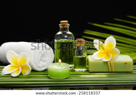 Spa set on long leaf with towel - stock photo