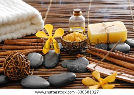 SPA set on mat with cinnamon - stock photo