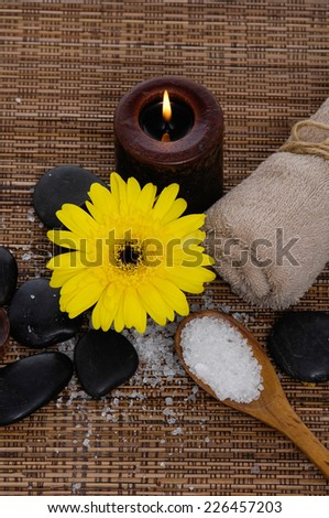 Spa set on wicker mat with pile of salt  - stock photo