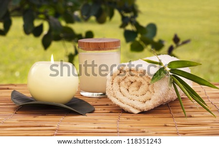 Spa set with a candle outdoors - stock photo