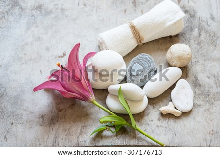 SPA set with stones and lilly flowers - stock photo
