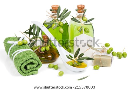 Spa setting of green olive: oil, soap, cream, gel, candle,  towel and raw olives. Isolated on white background. - stock photo