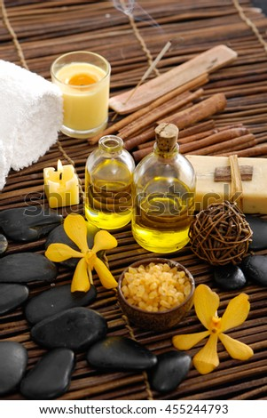 Spa setting on mat with pile stones - stock photo