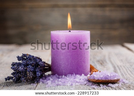 Spa setting with candle, salt and dried flower - stock photo
