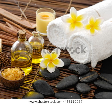 Spa setting with candle ,towel, oil with mat texture - stock photo