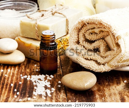 Spa Setting with Essence Oil,Natural Soap,Soft Towel and Sea Salt  - stock photo