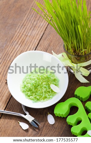 Spa Setting with green pedicure spacers and bath salt still life - stock photo