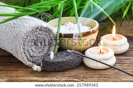 Spa Setting with Green Plants and Burning Incense on Wooden Background - stock photo