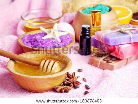 Spa setting with natural soap and sea salt closeup - stock photo