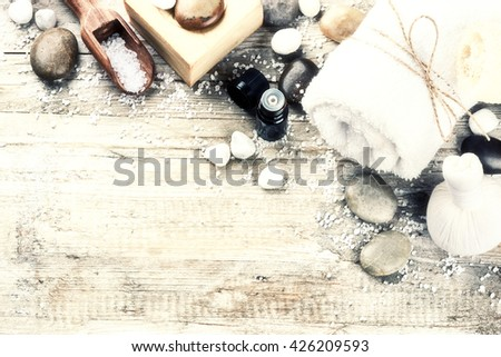 Spa setting with natural soap, herbal massage ball and essential oil. Wellness concept with copy space   - stock photo