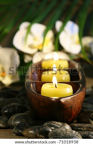 Spa setting with pebbles, candles for wellness concept - stock photo