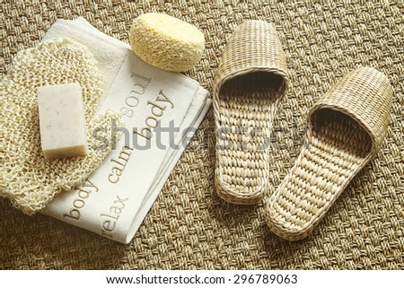 Spa setting with slippers, towel and soap - stock photo