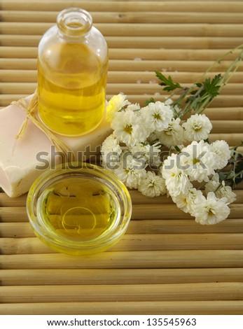 Spa sitting on bamboo mat - stock photo