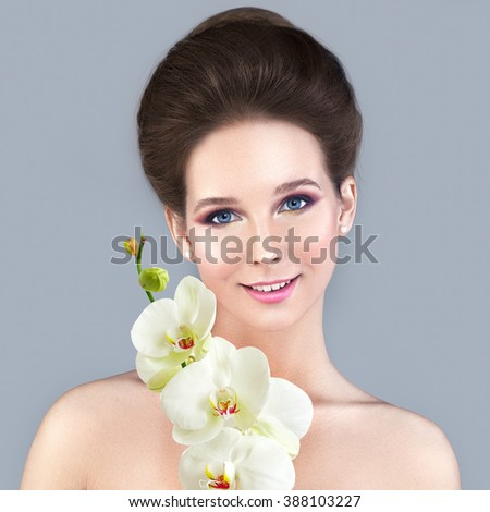 Spa Skin Care Concept. Healthy Woman with Clear Skin and White Orchid Flower - stock photo
