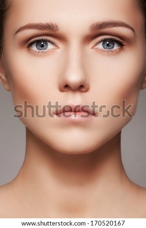 Spa, skincare, wellness & health. Close-up portrait of beautiful female model face with purity health skin & light make-up. Daily routine  - stock photo
