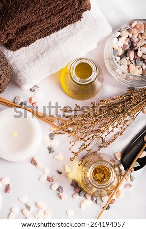 SPA still life: candles, aromatic oil, towels - stock photo