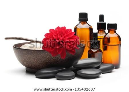 Spa still life,massage oil,zen stones, bowl of salt. - stock photo