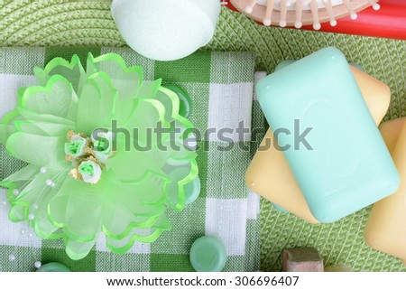 Spa still life with aromatic candles, sea salt, stones, flower and towel, close up - stock photo