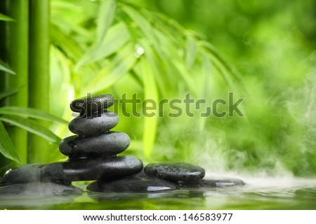 Spa still life with bamboo zen stone - stock photo