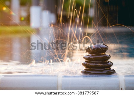 Spa still life with drops water lily and zen stone in a serenity pool  - stock photo
