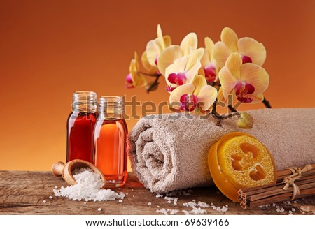 Spa still life with essential oils and orchid - stock photo