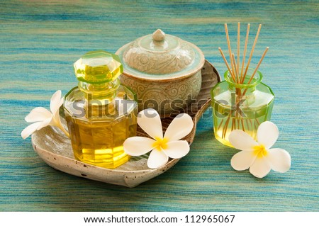 Spa still life with herbal massage ball, exfoliation salt scrub and and spa accessories. - stock photo