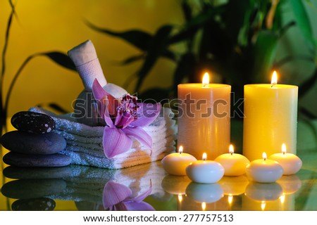 spa still life with lilac orchid on dark background - stock photo