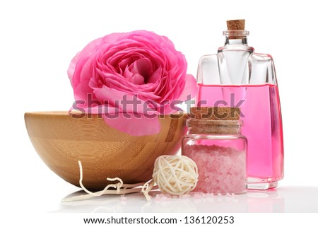 Spa still life with persian buttercup flower,bath salt and massage oil. - stock photo