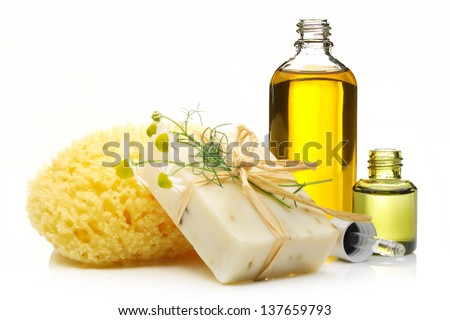 Spa still life with soap,sponge and cosmetic oil isolated on white background. - stock photo