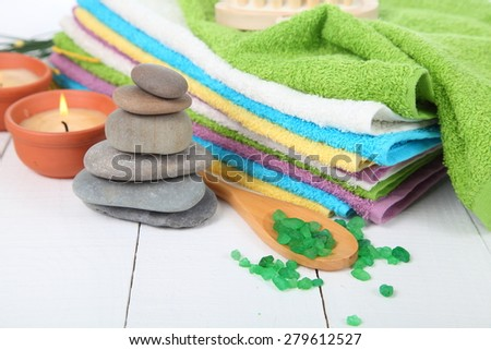 Spa still life with stones, sea salt and towel - stock photo
