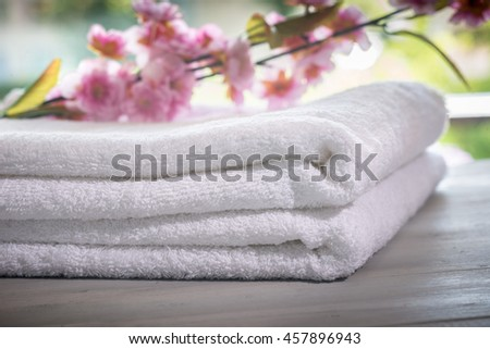 Spa still life with towels and pink orchid. Hotel and resort service concept. - stock photo