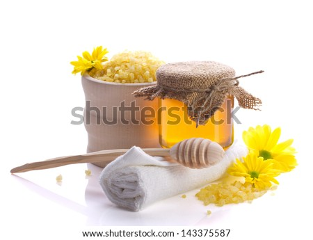 spa still with honey,  bath salt and flowers isolated on white - stock photo